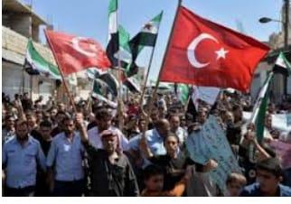 Suriye'nin kuzeybatısındaki İdlib kentinde halk, Türkiye'nin bölgedeki askeri varlığını destekleyen gösteriler düzenledi.